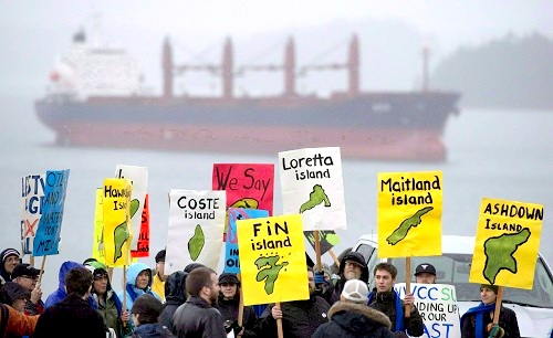 A group of protesters gathers outside the Northern Gateway hearings in Prince Rupert, B.C. on December 10th 2012 (JONATHAN HAYWARD/REX/Shutterstock)