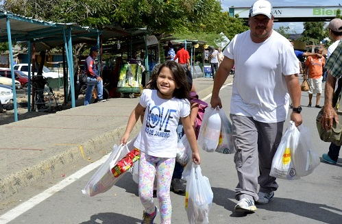 Venezuelan citizens cross the border with Colombia to buy food and other products in San Jose de Cucuta on 10 July. (Xinhua News Agency/REX/Shutterstock)