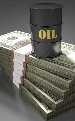 Photo illustration shows an oil barrel and stack of money. (Stefan Klein / imageBROKER/REX/Shutterstock)