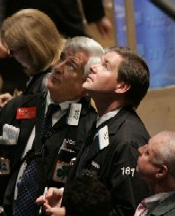 NYSE traders watch on 6 September as oil prices fall and share prices rise