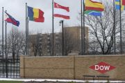Flags fly at an entrance to Dow Chemical in Midland, Michigan