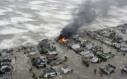 Homes burn as Galveston floods
