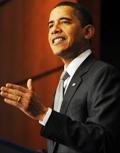 Obama sees economic progress but more struggle too