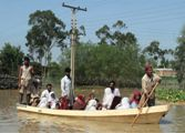 People being evacuated on boats in Pakistan worst floods in 80 years