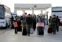 Egyptians return home from Libya