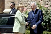 German Chancellor Angela Merkel and Italian Prime Minister Mario Monti meeting on 22 June
