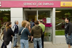 Jobless people queue outside Spanish employment office
