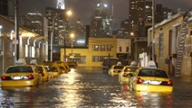 Taxi cabs line a flooded street