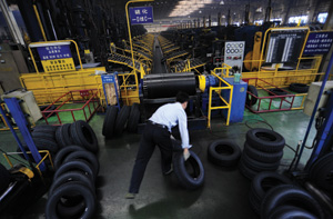 Asian tyre production Rex Features