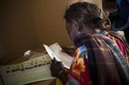 Kenyan woman casting her vote at a polling station in Nairobi