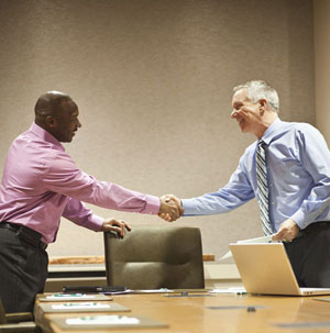shaking hands Rex Features