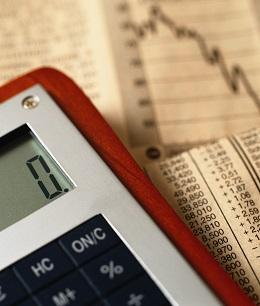Photographer PhotoAlto/REX Shutterstock VARIOUS Calculator on top of financial charts 2000