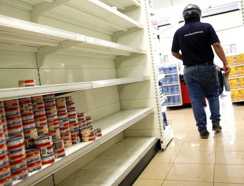 Empty supermarket shelves in Caracas illustrate the critical conditions in Venezuela. (Agencia EFE/REX/Shutterstock)