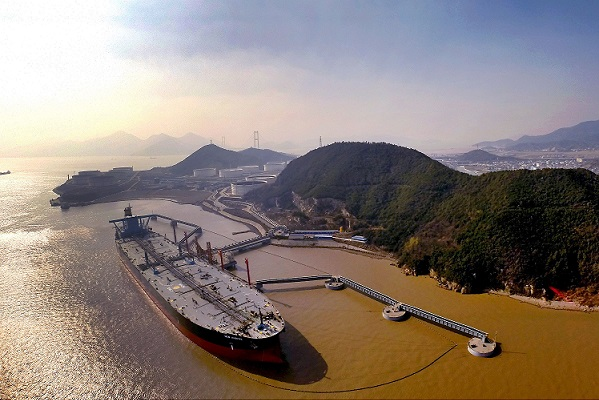 Crude oil is being unloaded from an oil tanker on a quay in Zhoushan city, east China