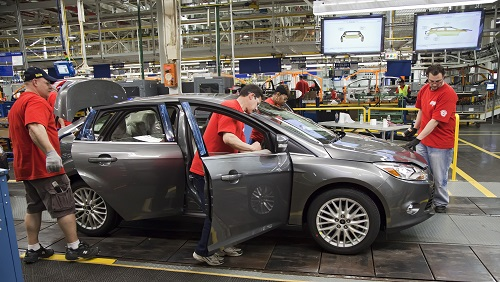 Ford Motor is moving all small-car production to Mexico. Above, workers assemble a 2012 Ford Focus at Ford Motor Company