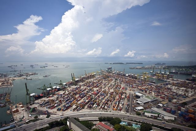 Containers and container ships at Singapore port 06 October 2016