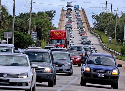 Residents evacuate on Wednesday, 5 October 2016, from Merritt Island, Florida. Officials began evacuating Florida