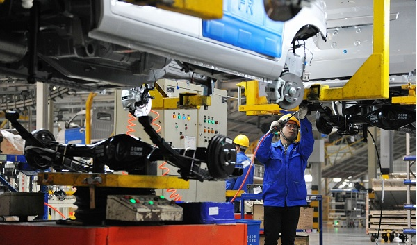 Picture: A Chinese worker assembles cars on the assembly line at an auto plant (Imaginechina/REX/Shutterstock)