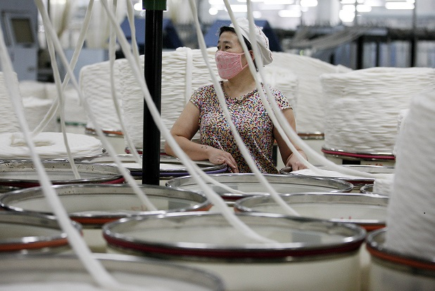 worker at China textile factory 1 August