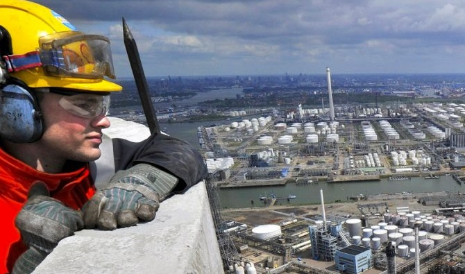 Shell Pernis worker observes site. Source - Shell