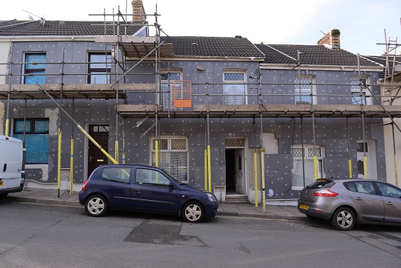 EPS insulation being fitted to houses in the UK. Source - Graham Harries, REX, Shutterstock
