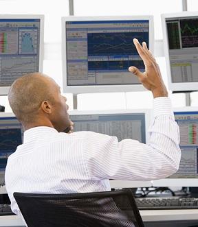 Trader talks animatedly on phone